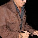 Johnny Depp signs autographs after long day of shooting
